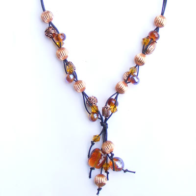 Shiney reduced lampwork beads and copper necklace