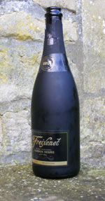Empty bottle of black glass which used to contain Spanish Cava