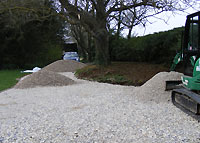 Piles of gravel and limestone on my new driveway
