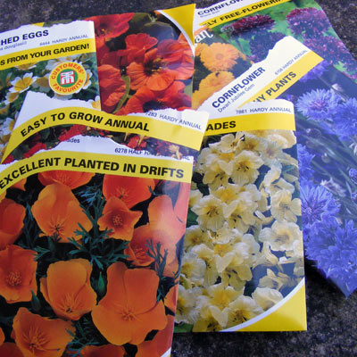 Hardy annual seed packets showing colourful plants that will soon brighten my garden, I hope