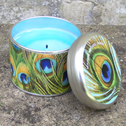 Scented candle in a tin with a peacock feather design