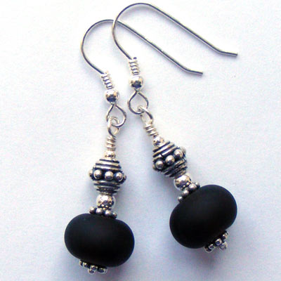 Handmade lampwork beads made from recycled Cava bottle glass and turned into sterling silver earrings