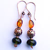 Hand made lampwork bead made with recycled wine bottles, copper beads and genuine baltic amber beads earrings