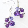 Handmade transparent purple lampwork beads gathered together with amethyst and sterling silver beads into a sterling silver tube earrings