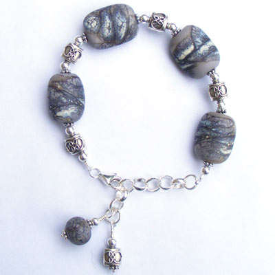 Handmade bracelet with lampwork beads and fair trade Karen Hill tribe sterling silver beads