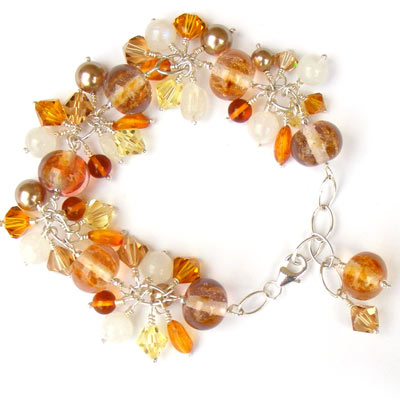 Handmade bracelet with lampwork glass beads, amber, moonstone and swarovski crystal