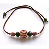 Handmade lampwork recycled glass beads on a simulated leather thong